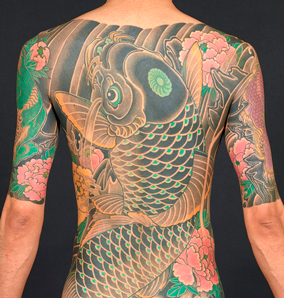 Tattoo by Miyazo. Photo by Kip Fulbeck.