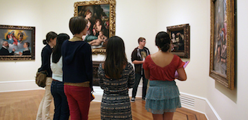 People looking at Paintings