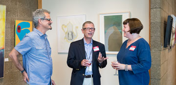 Artists in conversation at a Studio School reception